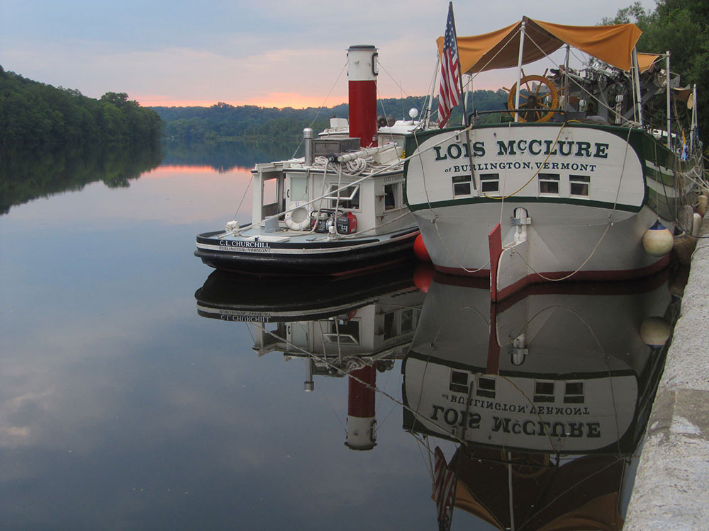 C.L. Churchill tugboat and Lois McLure canal barge from aft, docked, evening