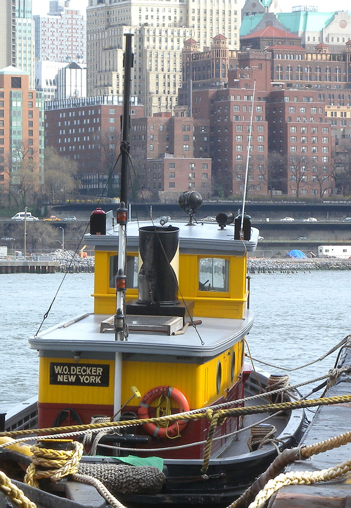 tugboat W.O. Decker, view from aft with New York City across river